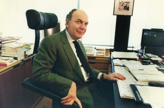 The Italian publisher Leonardo Mondadori sitting at the desk in his office. Segrate, Milan (Italy), 2001.