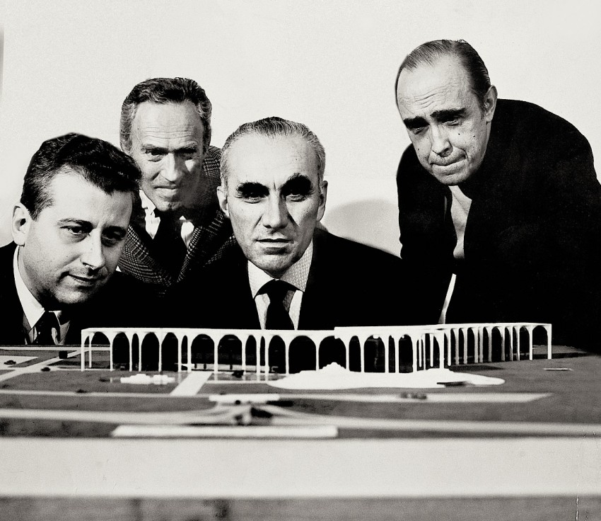 Oscar Niemeyer with Giorgio Calanca, Giorgio Mondadori and Luciano Pozzo with the model of the building from the first project.